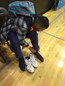 Foster tries on his brand new Charlotte Hornets basketball shoes!