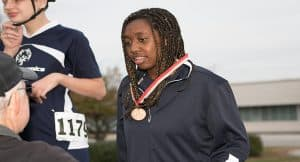 Athlete Yasmin Neal receiving a medal